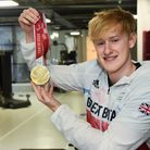 Paralympian swimmer Jordan Catchpole, 21, from Beccles, at his gym in the town, with his gold medal