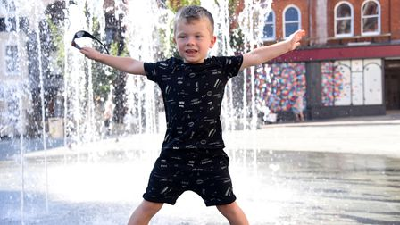 Lucus enjyoing the fountains in Ipswich PIcture: CHARLOTTE BOND