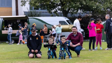 Two men, two children with bicycles, Dunmow Cricket Club spectators