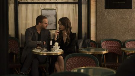 Emily and Thomas at the Cafe de Flore. Pic: Carole Bethuel/Netflix