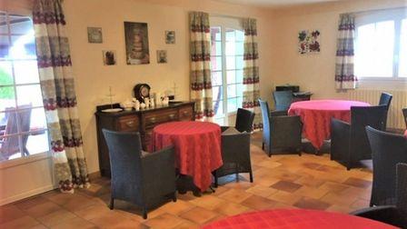 The large living and dining room could be set up for business or as a home