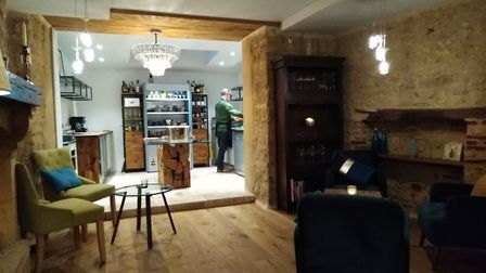 The lounge and open-plan kitchen