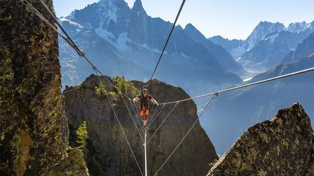 Try your hand at a new experience like via ferrata this year. Pic: Subbotsky/Getty