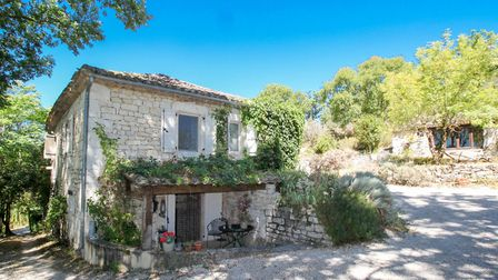 This charming abode comes with a gite, woodland, swimming pool, stables and petanque court