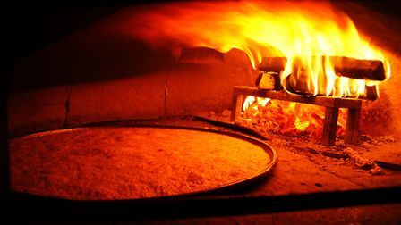 Socca is cooked in a wood-fired oven at Chez Pipo © Steeve Bernardo Chez Pipo