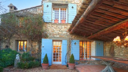 Pretty blue shutters on a beautiful French home