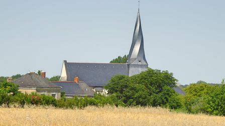 Pontigne's twisted church spire peeks out above a corn field. Pic: Alison Hughes