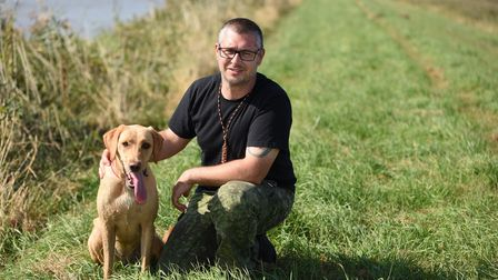 Stephen Mace, lead project officer for the Norfolk Rivers Trust, with River, his 18-month-old labrad