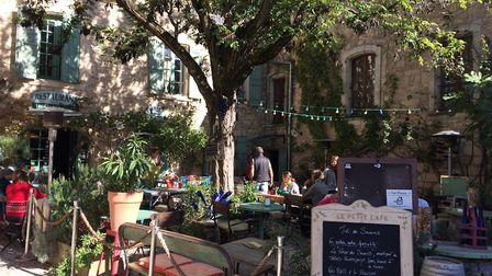 Courtyard cafe in Provence (c) Catharine Higginson