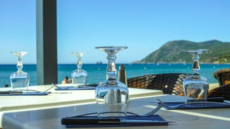 Cafe with a sea view on the French Riviera (c) barmalini / Getty Images