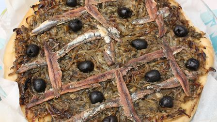 Pissaladière made with caramelised onions, black olives, and anchovies (c) nobtis / Getty Image