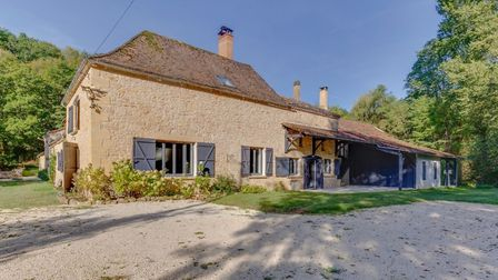 The main house offers spacious living accommodation and a modern, well-stocked kitchen