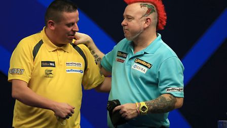 Peter Wright consoles Dave Chisnall, left, after defeating him during day 12 of the William Hill PDC