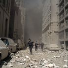 Emergency workers move through the debris from the collapse of the World Trade Center in New York