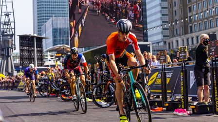 Tearing through WestIndia Quay in triathlonsecond stage cycle race