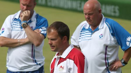 England's Jamie Chestney, centre, in action against Scotland in the Men's Fours final at the 2014 Co