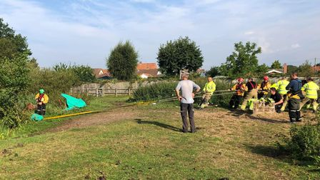 Sixteen firefighters were needed to pull out a 32-year-old horse which had become stuck in a pond on Holly Lane in Mutford.