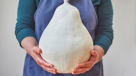 Artist Cathy Outen with one of her giant ceramic pears
