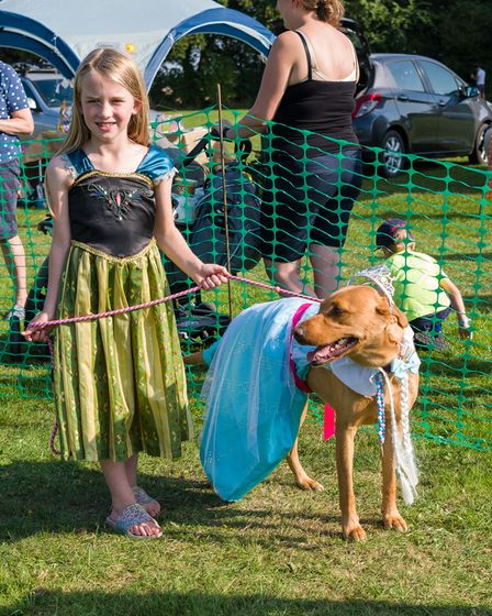 A girl and a dog, both wearing costume, for Felsted fun dog show, Essex