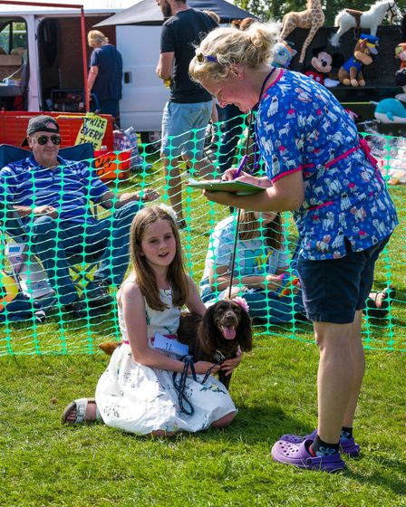 A girl, her dog and the show judge at Felsted fun dog show, Essex