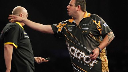 Adrian Lewis on his way to victory over Andrew Gilding