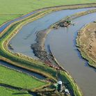 An aerial shot of the River Yare after construction of new, EA-funded set-back banks.