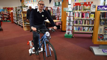 Bruce doing his bit for charity inside the library