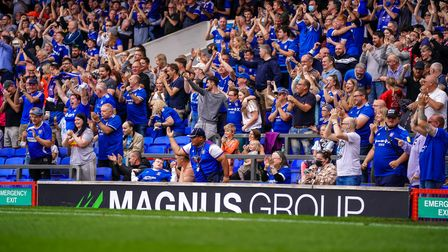 Town fans celebrate their opening goal.