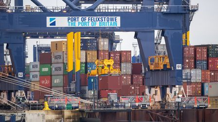 Shipping containers are unloaded from a cargo ship at the Port of Felixstowe in Suffolk. Shipments o