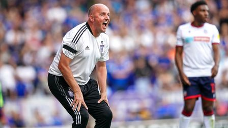 Town manager Paul Cook screaming at his players.