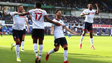 Bolton Wanderers' Josh Sheehan (centre) celebrates scoring his side's fourth goal of the game during
