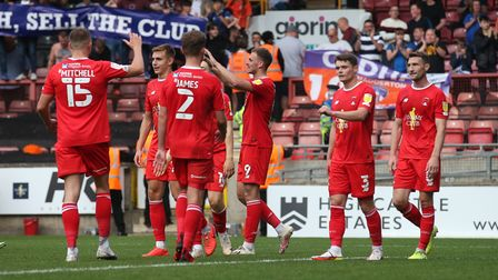 Harry Smith of Leyton Orient scores the fourth goal for his team and celebrates with his team mates