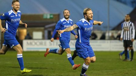 Robert Eagle of Lowestoft Town (right) celebrates scoring his team's fourth goal against Corby Town