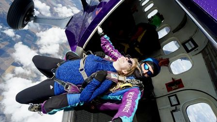Head teacher Bridget Harrison shows she has nerves of skill after completing a remarkable sky dive