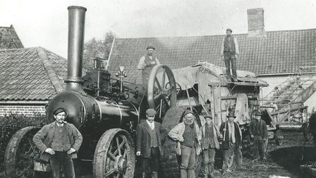A steam threshing team led by Robert Hines on the engine capture at Town Farm, Thorndon, around 1915