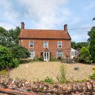 Pretty brick-built farmhouse set behind a brick and flint wall for sale by auction in Upper Stoke Holy Cross, Norfolk