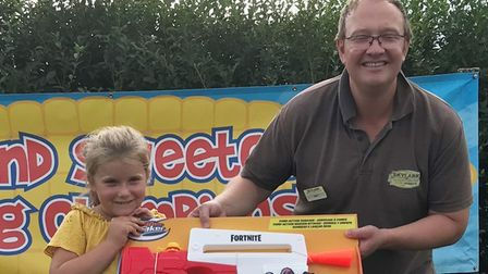 Lily Szopa of Wisbech with her Skylark sweetcorn eating competition prize 2021