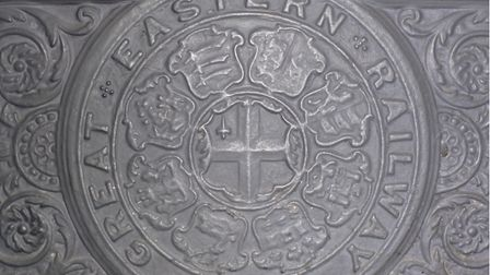 The Great Eastern Railway sign on the chapel's fireplace.