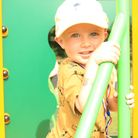 A youngster enjoys the new play area at Yaxham Village Hall