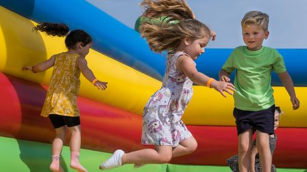 Children on a bouncy castle at the Flitch Green Fun Day 2021, Essex