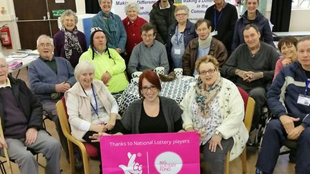First Focus co-ordinator April Simnor, front centre, with volunteers of the charity in their new hom