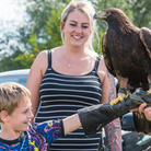 Two images from the Flitch Green Fun Day 2021, Essex: Face painting and eagle handling