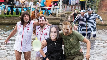 The adults three-legged race underway in Finchingfield - is that Harry and Megan in the water?