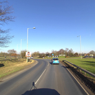 Two ponies are in the road at a roundabout on the A12 at Melton