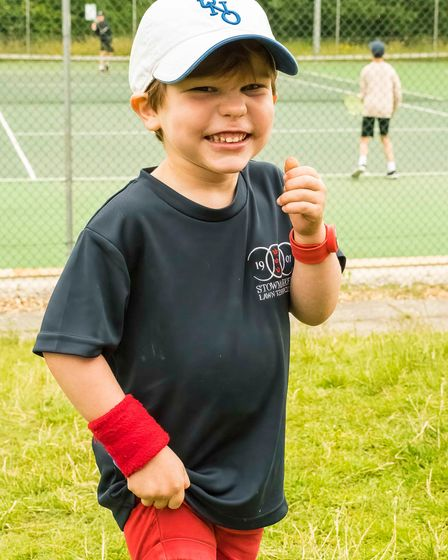 A young tennis lover at Stowmarket Lawn Tennis Club in Ilfie Way