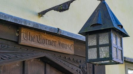 Close up of wooden house name reading 'The Corner House', which is for sale in Kersey, Suffolk