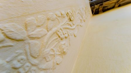 Close up of intricate plaster work on the exterior of this four-bedroom, 15th century home for sale in Kersey, Suffolk