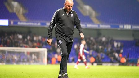 Town manager Paul Cook walks away at the end of the match.