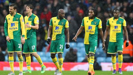 The Norwich City players after going 1-0 down at Aston Villa. Picture: Paul Chesterton/Focus Images