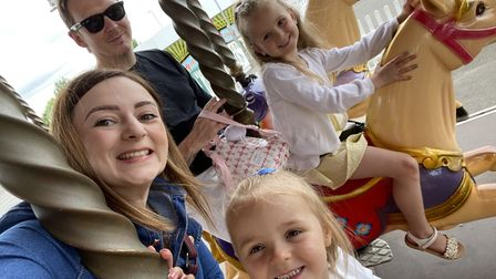 Isla and Esme Thornhill (Right) pictured with Mum, Willow and Dad, Aaron.